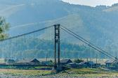 Old suspension bridge above Katun — Stock Photo