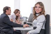 Young business lady smiling in office — Stock Photo