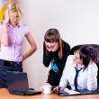 Three pretty businesswomen in office — Stock Photo
