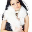 Attractive girl wearing white fur — Stock Photo #43229529