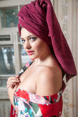 Pretty woman with a towel — Stock Photo