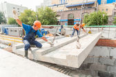 Builders working on residental house construction — Stockfoto