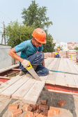 Builders working on residental house construction — Stock Photo