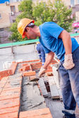 Bricklayer on house construction — Stock Photo