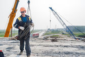 Worker on construction of bridge — Stockfoto
