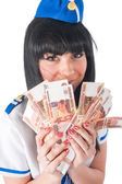 Young beautiful air hostess with cash — Stock Photo