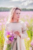 Beautiful sad girl on meadow — Stock Photo