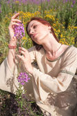 Beautiful red-hair girl on meadow — Stock Photo