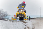 Jump of sportsman on snowmobile — Foto Stock