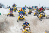 Racing of sportsmen on snowmobile — Stock Photo