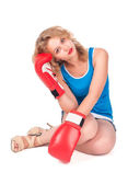 Pretty sad girl with boxing gloves — Stock Photo