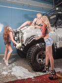Three sexy women washing car — Foto Stock