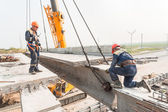 Workers establish bridge span — Stock Photo