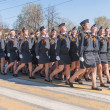 Female cadets of police academy marching on parade — Stock Photo