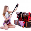 Young sexy woman near old suitcase — Stock Photo