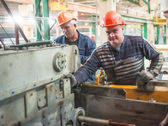 Workers set up equipment — Stock Photo