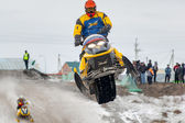 Jump of sportsman on snowmobile — Stock Photo