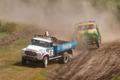 Sport trucks racing on unpaved track — Stock Photo