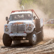 Truck on bend of sports route — Stock Photo #47774403
