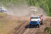 Trucks racing on unpaved sport track — Stock Photo