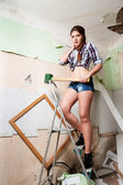 Attractive brunette woman with sledge hammer — Stock Photo