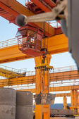 Crane operator works at finished goods warehouse — Stock Photo