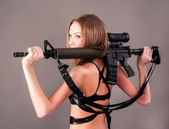 Attractive woman holding sniper rifle — Stock Photo