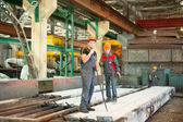 Workers on plant of ferroconcrete products — Stock Photo