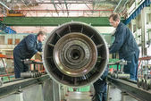Workers assembly aviation engine — Stock Photo