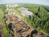 Scrap metal and iron dump at evening — Stock Photo