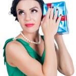 Постер, плакат: Attractive woman listens sounds from box