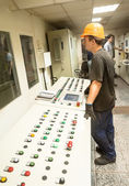 Engineers operate production conveyor — Photo