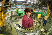 Woman cleans part for aviation engine — Stok fotoğraf