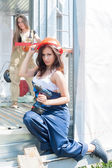 Attractive women on construction site — Stock Photo