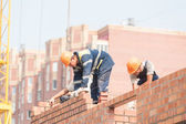 Bricklayers on house construction — Stock Photo