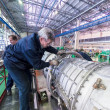 Постер, плакат: Mechanics work over assembly of aviation engine