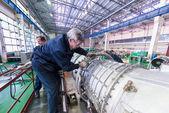 Mechanics work over assembly of aviation engine — Stok fotoğraf
