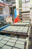 Worker at machine on stone blocks drying — Stock Photo