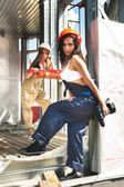 Attractive young women on construction site — Stock Photo
