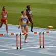 Stock Photo: Athletes in finish of 400 meters race