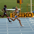 Stock Photo: Athletes in the finish of 400 meters race