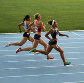 Athletes in the 400 meters race — Stock Photo