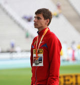 Aleksandr Ivanov of Russia - silver medalist of 10,000 m. race walk on the podium on the 2012 IAAF World Junior Athletics Championships on July 13, 2012 in Barcelona, Spain — 图库照片