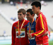 Aleksandr Ivanov, Eider Arévalo, Guanyu Su winners of 10,000 walk on podium on the 2012 IAAF World Junior Athletics Championships on July 13, 2012 in Barcelona, Spain — Stockfoto