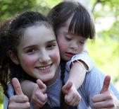Portrait of beautiful young girls outside. — Stock Photo