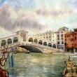 A view of the canal with Rialto bridge, boats and buildings in Venice, painted by watercolor - Stock Photo