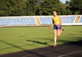 Athletic girl on the track . — Stock Photo