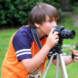 Royalty-Free Stock Photo: Young photographer takes pictures on the nature
