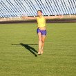 Beautiful teenage sport girl running on the stadium grass. — Stock Photo #13636017