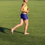 Beautiful teenage sport girl running on the grass. — Stock Photo #13707215